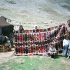 A large Karakoyunlu kilim on the Anamas Yayla with weavers (Harald Böhmer, Nomads in Anatolia 2008)