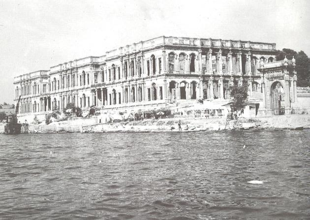 View from the sea of the burnt shell of Ciragan Palace and the main waterront gate, 1976